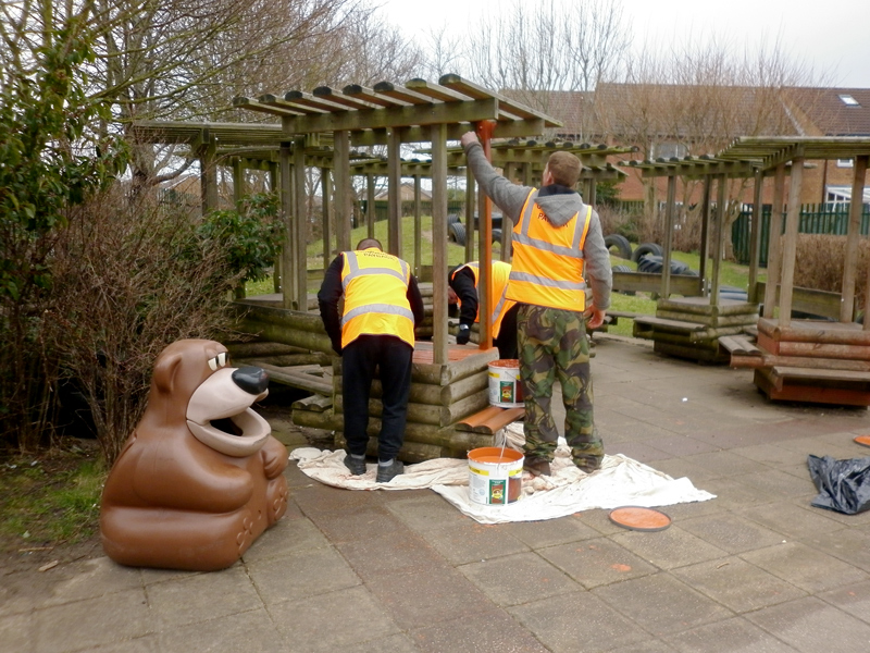 Community Payback service users at work in the grounds of Bowsland Green Primary School, Bradley Stoke.