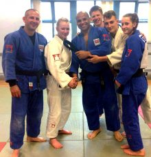 Bradley Stoke Judo Club's Eleanor Young (2nd from left) is presented with her black belt.