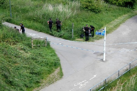 Police search an area in the Three Brooks Local Nature Reserve, Bradley Stoke.
