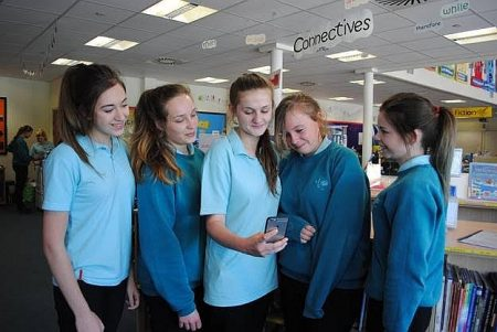Bradley Stoke Community School students Lisa Millichamp, Laura Phillips, Jess Lomax, Amy Powell and Emily Hammond demonstrate their 'Pen Friend' phone app.