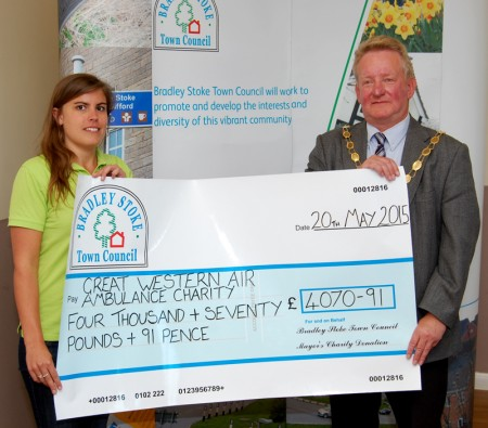 Community fundraising organiser Ella Mayne of GWAAC receives a charity collection cheque from Cllr John Ashe, mayor of Bradley Stoke.