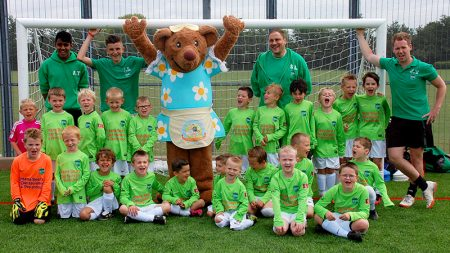 Almondsbury FC Under-8s team in kit sponsored by Mama Bear's Day Nursery.