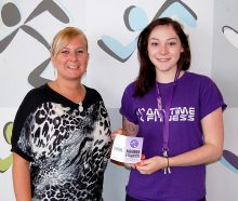 Prize draw winner Natasha Thwaites (left) receives her membership card from Chloe Depledge, club manager at Anytime Fitness Bradley Stoke.