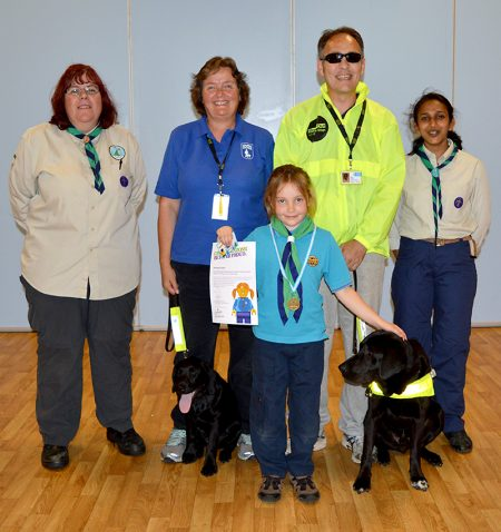 Jemima Grinter (centre) with (l-r) Donna Carl (assistant Beaver Scout leader), Annette Tadman (puppy walker for Guide Dogs, with Guilda), John Tovey (with Dez) and Beena Chheda (Beaver Scout leader).