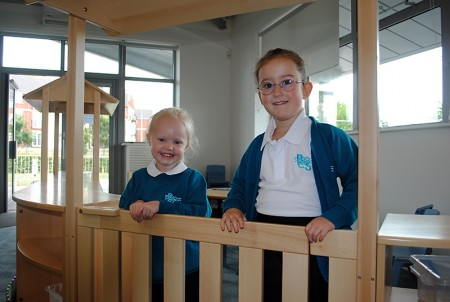 Pupils due to start in the Reception class at BSCS in September try out a play area in one of the classrooms.