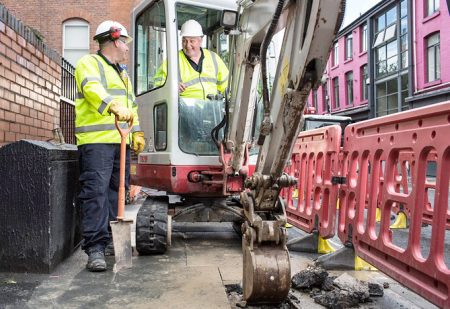 Mini-excavators digging trenches in pavements, which could soon become a familiar sight in Bradley Stoke.