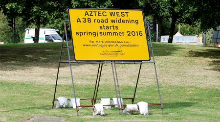 Sign advertising consultation on a road widening scheme at the Aztec West Roundabout.
