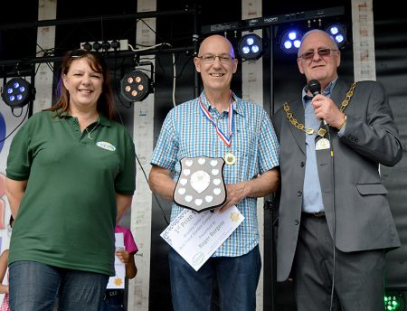 Bradley Stoke in Bloom (BSiB) Best Front Garden competition winner Roger Burgess (centre) with BSiB's Sara Messenger (left) and Bradley Stoke Mayor Roger Avenin.