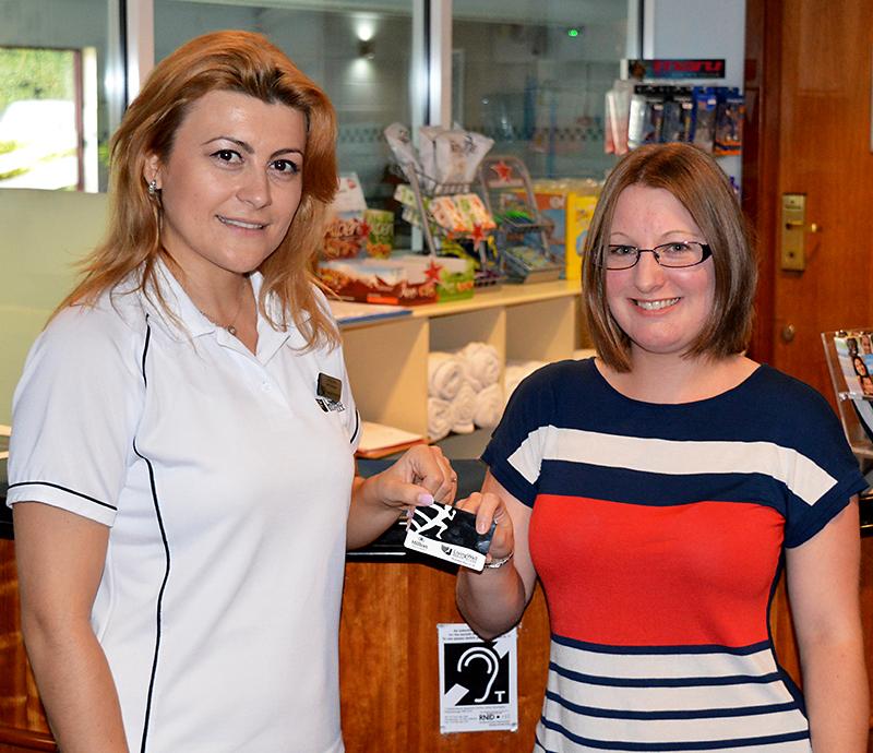 Katy Robinson (right) receives her membership card from Anca Leru, manager of LivingWell Health Club, Hilton Bristol Hotel.