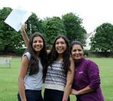 Red Maids' School GCSE results: Neha Mehta (centre) celebrates with her mother Sapna and younger sister Niki, also a Red Maid.