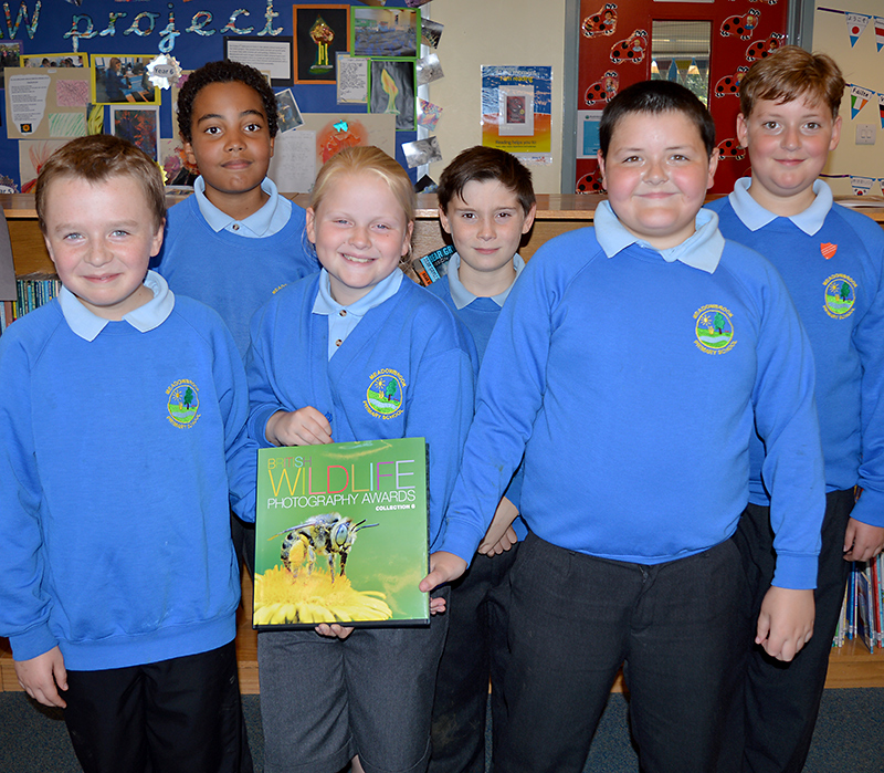 British Wildlife Photography Awards 2015 - Meadowbrook Primary School Year 6 pupils with a copy of the hardback book that includes their winning photographs.