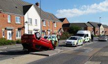 Overturned car on Brook Way, Bradley Stoke, Bristol.