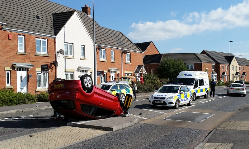 Overturned car on Brook Way, Bradley Stoke, Bristol.