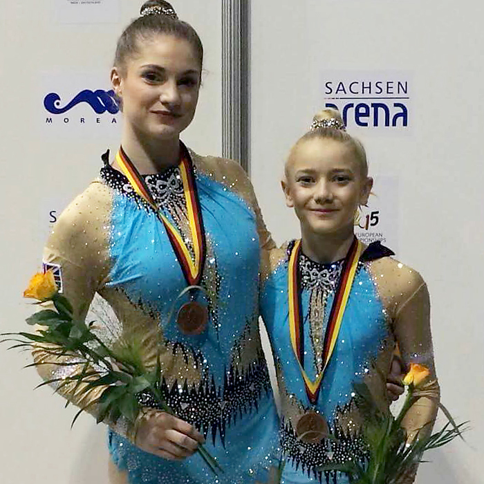 Abigail Hipkiss (left) and Tiana McClurg, pictured after being presented with their bronze medals at the European Acrobatic Gymnastics Championships.
