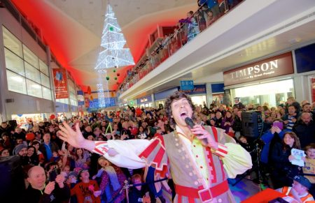 Andy Day switches on the Christmas lights at the Willow Brook Centre in Bradley Stoke, Bristol.