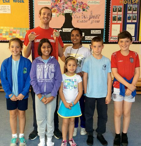 GB Paralympian Ben Rushgrove with pupils at Meadowbrook Primary School, Bradley Stoke, Bristol.