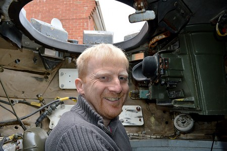 Jeff Woolmer, sitting in the commander's seat of the Scorpion tank he purchased through a online auction site.