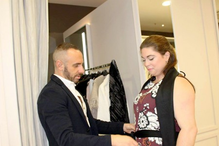 TV stylist Mark Heyes puts the finishing touches to Natalie Welsh's catwalk look for Bristol Fashion Week AW2015.