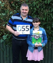 Brian and Hollie Bleaken, holding their 'Shaun in the City' auction programme and bidding card.