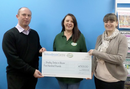 Representatives of the Willow Brook Centre present a cheque for £500 to Sara Messenger (centre) of Bradley Stoke in Bloom.