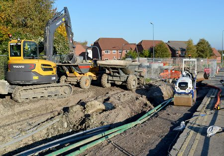 MetroBus construction at Woodlands Lane: Gas main and complex cable ducting have caused delays.