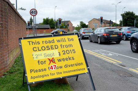 "Woodlands Lane is now not expected to re-open until ""approximately August 2016"", 47 weeks after it was closed for MetroBus construction work."