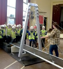 Staff from Alun Griffiths (Contractors) Ltd present the 'Bridge to Schools' project at Little Stoke Primary School.