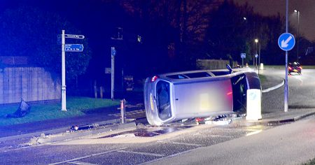 A vehicle lies on its side on Brook Way, Bradley Stoke, after apparently striking a traffic island that separates a cycle lane from the main carriageway, in the vicinity of a speed cushion an informal pedestrian crossing.