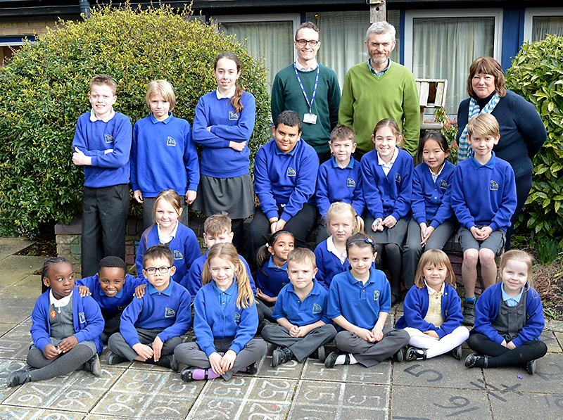 Staff and pupils at Holy Trinity Primary School, Bradley Stoke celebrate their recent 'good' Ofsted report.