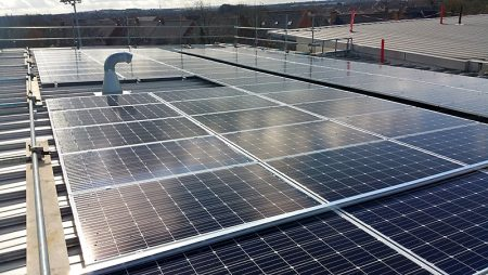 Solar panels being installed on the roof of Bradley Stoke Community School.