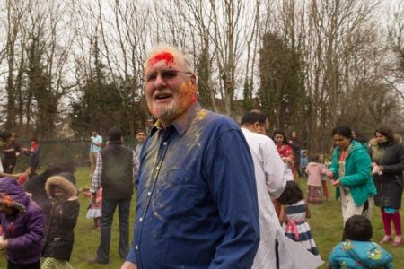 Bradley Stoke Mayor Roger Avenin attends a Holi celebration.