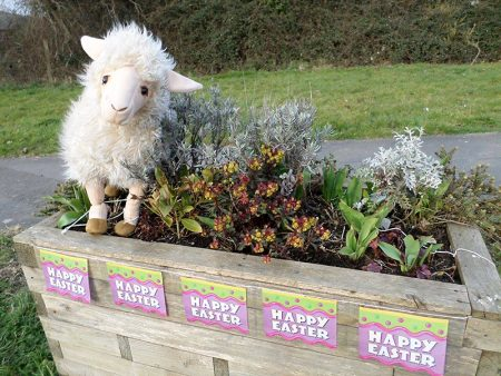 Welcome planter decorated for Easter by Bradley Stoke in Bloom.