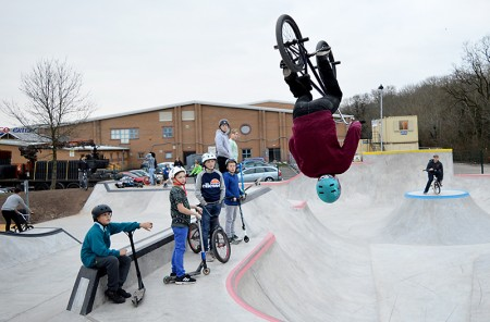 A BMX rider performs a stunt at the new skate park in Bradley Stoke, Bristol.