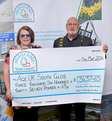 Cllr Roger Avenin presents a mayor's charity cheque to Michelle Dent of Age UK South Gloucestershire.