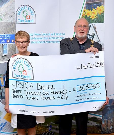 Cllr Roger Avenin presents a mayor's charity cheque to Linda Harper, a trustee of the RSPCA's Bristol & District Branch.