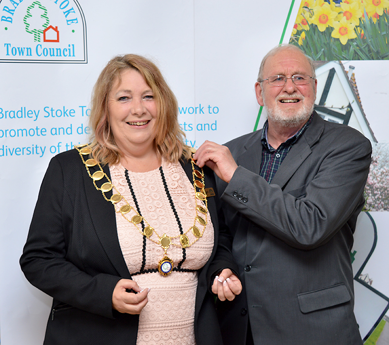Newly-elected Mayor of Bradley Stoke Cllr Elaine Hardwick (left) receives the chain of office from previous mayor Cllr Roger Avenin.