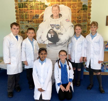 Meadowbrook Primary school pupils with their very own Tim Peake! L-r: Steve Marling, Dax O'Conell, Kshirin Naveen Kumar, Maisie Shinton, Ruby Grimsted and Chloe Jones.