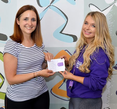 Davina Smythe (left) receives her membership card from Charlotte Maggs, club manager at Anytime Fitness Bradley Stoke.