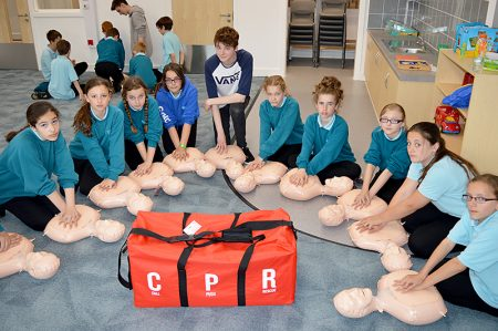 Year 7 students at Bradley Stoke Community School receive instruction in CPR from Post-16 students trained by the British Heart Foundation.