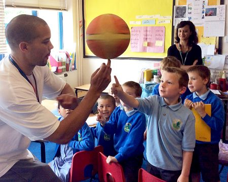 Bristol Flyers basketball player Doug McLaughlin Williams with Year 3 pupils at Meadowbrook Primary School, Bradley Stoke.