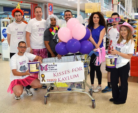 Staff at the Tesco Extra store in Bradley Stoke raise funds for the 'Kisses for Kaylum' appeal by taking part in a trolley push.
