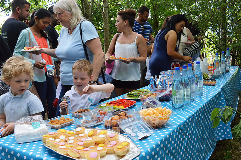 Refreshments in the forest school area at the BSCS primary phase end of year celebration.