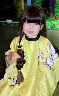 Lily Williams has her long hair cut off for donation to the Little Princess Trust.