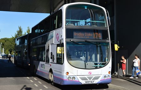 An X74 bus waits at the Willow Brook Centre, Bradley Stoke.