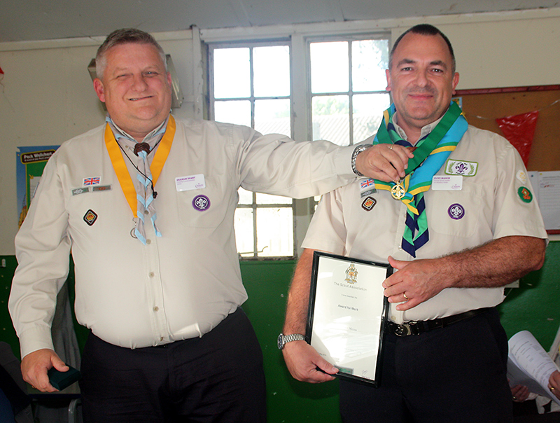 L-r: Graham Brant (Avon Scouts County Commissioner) presents the Scouting Award for Merit to Clive Mason (Group Scout Leader, 1st Bradley Stoke Scout Group).