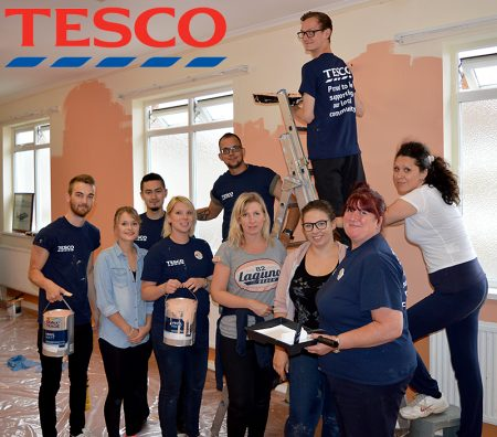 Staff from the Tesco Extra store in Bradley Stoke decorate a room at Patchway Community Centre.