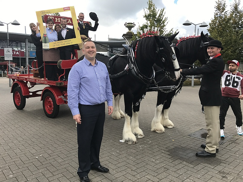 Gareth Ireland, general manager at the Aztec Hotel & Spa, with other hotel staff and the Thwaites shire horses at Bradley Stoke's Willow Brook shopping centre.