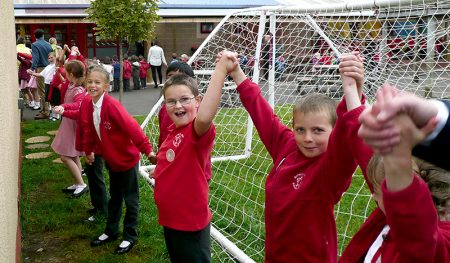 Celebrations to mark the 20th anniversary of Baileys Court Primary School: Building hug.