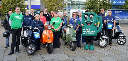 A team of classic scooter riders prepare to set off from the Tesco Extra store in Bradley Stoke on a charity relay in aid of Macmillan Cancer Support.