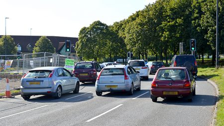 The westbound carriageway of Bradley Stoke Way at its junction with the Aztec West Roundabout.